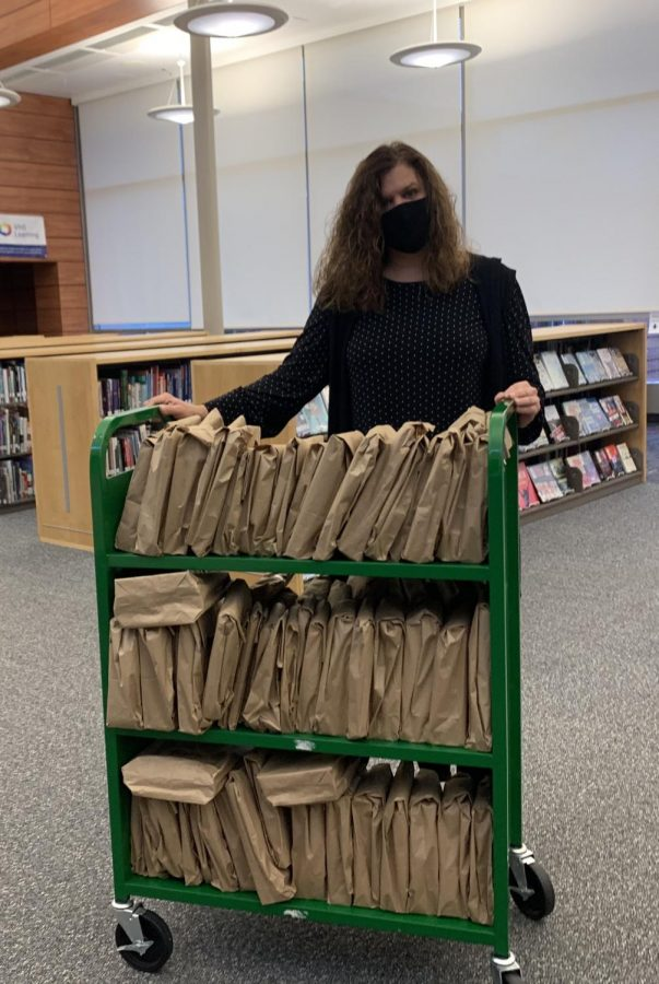 Mrs. Farmer getting ready for Date with a Book display